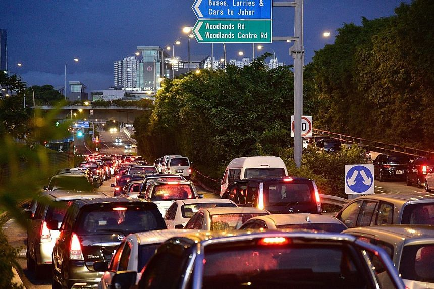 Long lines of vehicles near the Woodlands Checkpoint last Saturday. Several netizens took to the ICA's Facebook page to complain about the long queues to clear Customs and cross to Johor Baru last weekend.
