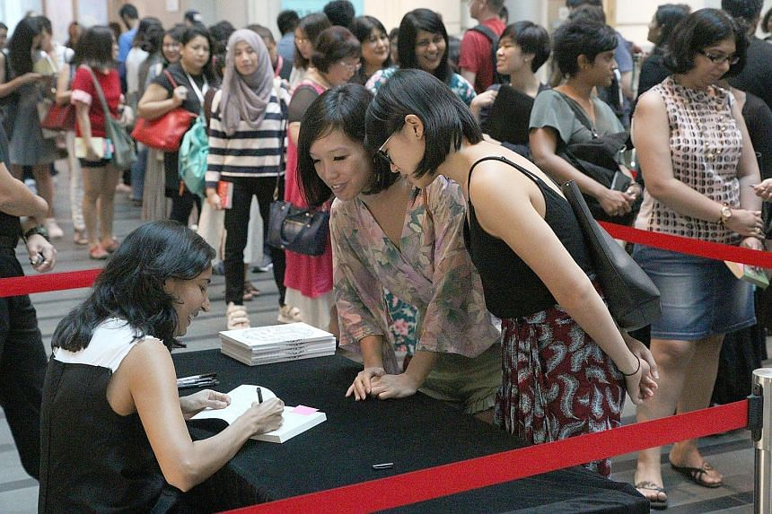 Indian author Kiran Desai (left) at her book signing during the Singapore Writers Festival last month.