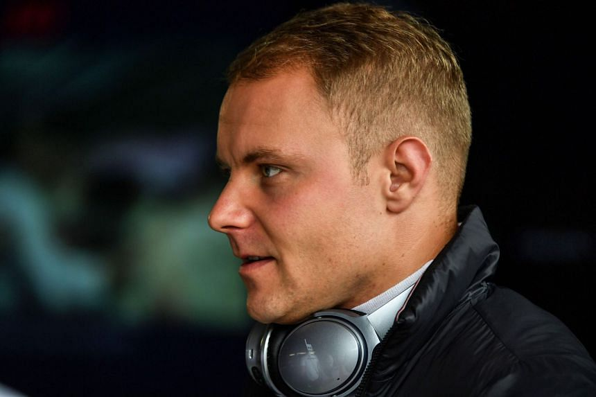 Mercedes' Finnish driver Valtteri Bottas is seen at the pits during a free practice session of the Brazil Grand Prix.