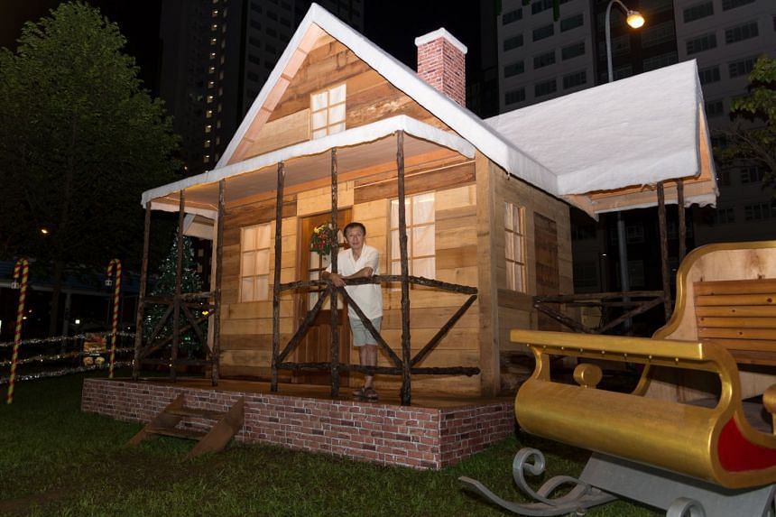 Carpenter Tan Koon Tat poses with the log house he built for his neighbourhood in Woodlands.