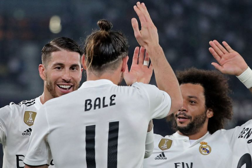 Real Madrid's Welsh forward Gareth Bale (centre) celebrates a goal with team mates.