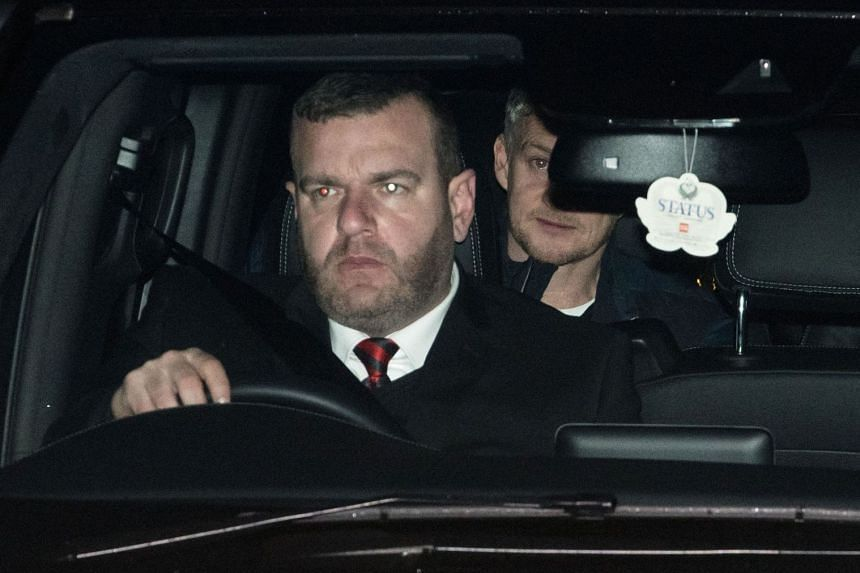 Manchester United's Norwegian caretaker manager Ole Gunnar Solskjaer is driven in to the club's Carrington Training complex on Dec 20, 2018. He has the daunting task of saving the club's season.