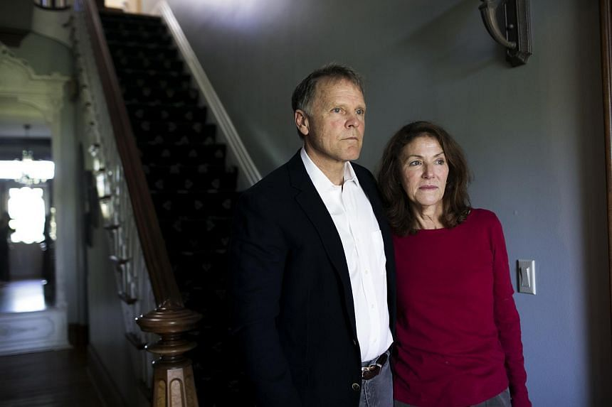 Fred and Cindy Warmbier, parents of Otto Warmbier, standing in their home in Wyoming, Ohio, in April 2017.