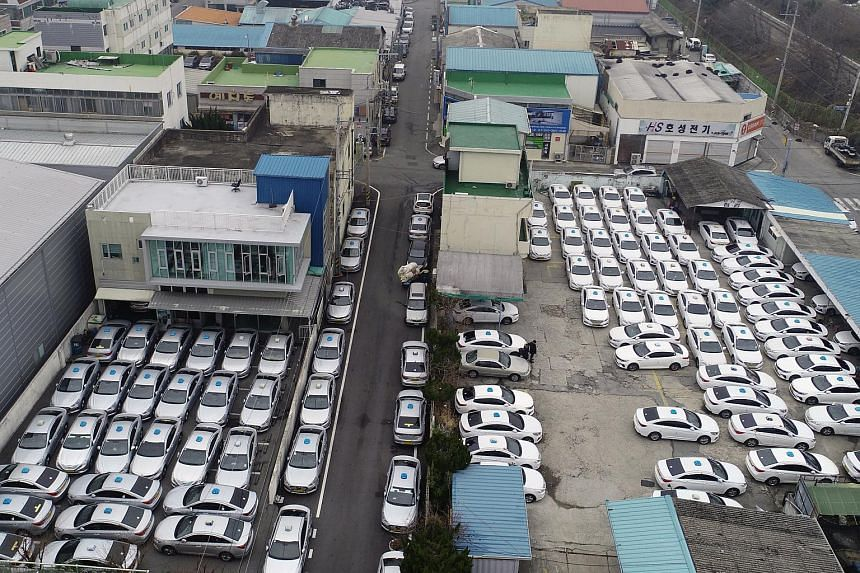 Taxis are parked at a garage during a nationwide one-day strike in Gwangju, South Korea, on Dec 20, 2019.