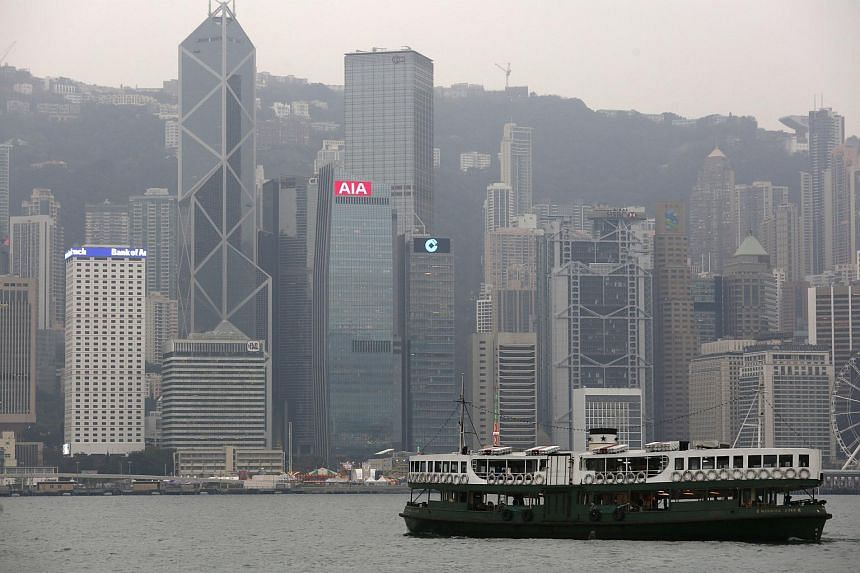 File photo showing a ferry sailing at Victoria Harbour in front of the financial Central district in Hong Kong on Feb 17, 2016.