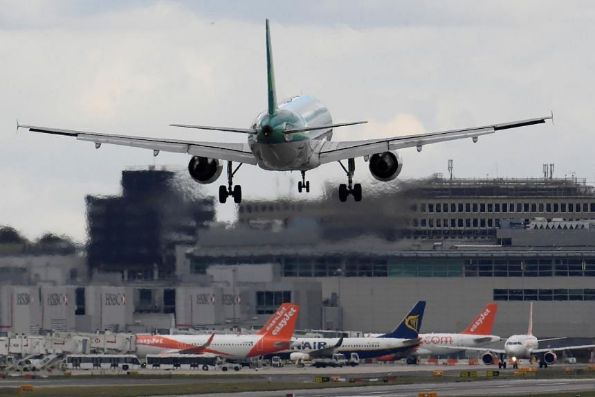 File photo showing a passenger aircraft landing at Gatwick Airport in southern England, Britain, on Oct 9, 2016.
