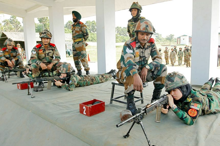 Female Afghan army cadets at a target-shooting practice session yesterday at the Officers Training Academy in the south Indian city of Chennai. A team of 19 female officers are undergoing the training, which is part of the Afghan National Army's effo