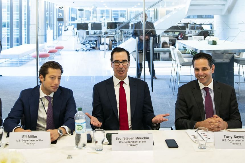 US Treasury Secretary Steven Mnuchin (centre), with Treasury chief of staff Eli Miller (left) and spokesman Tony Sayegh, at Tuesday's interview with Bloomberg. Mr Mnuchin said that while reducing the trade deficit with China is a major priority, the