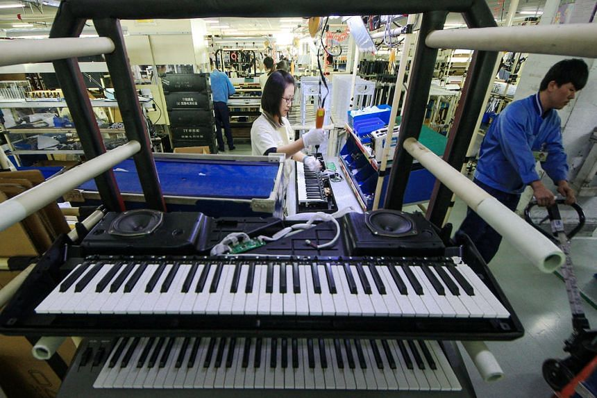 Chinese workers manufacturing electronic keyboards at a factory in Tianjin. China's large population and rapid wage growth have been significantly influencing the global average.