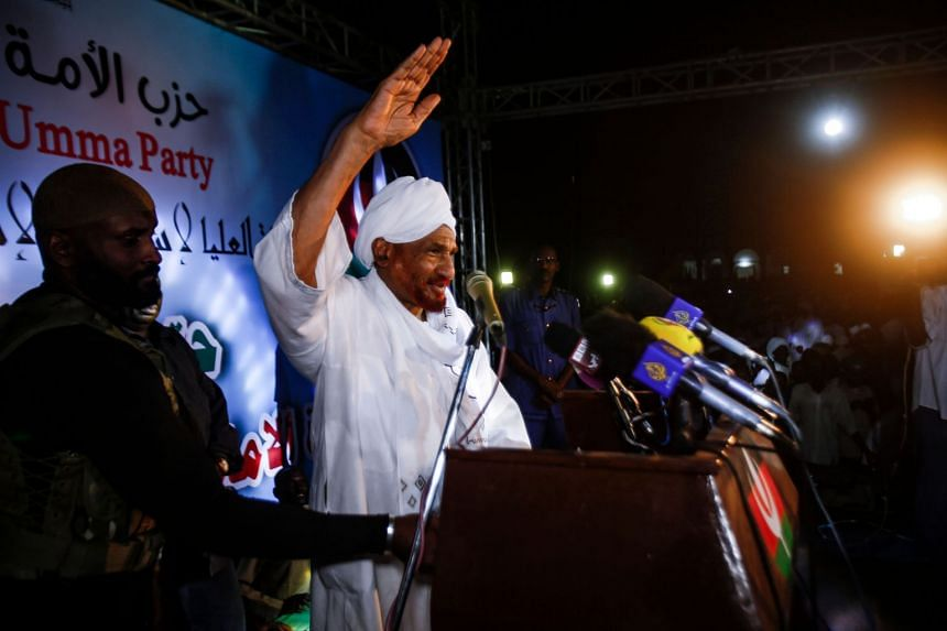 Sadiq al-Mahdi, Sudan's ex-prime minister and leader of the opposition National Umma Party, addresses supporters as he speaks in the capital Khartoum on Dec 19, 2018.