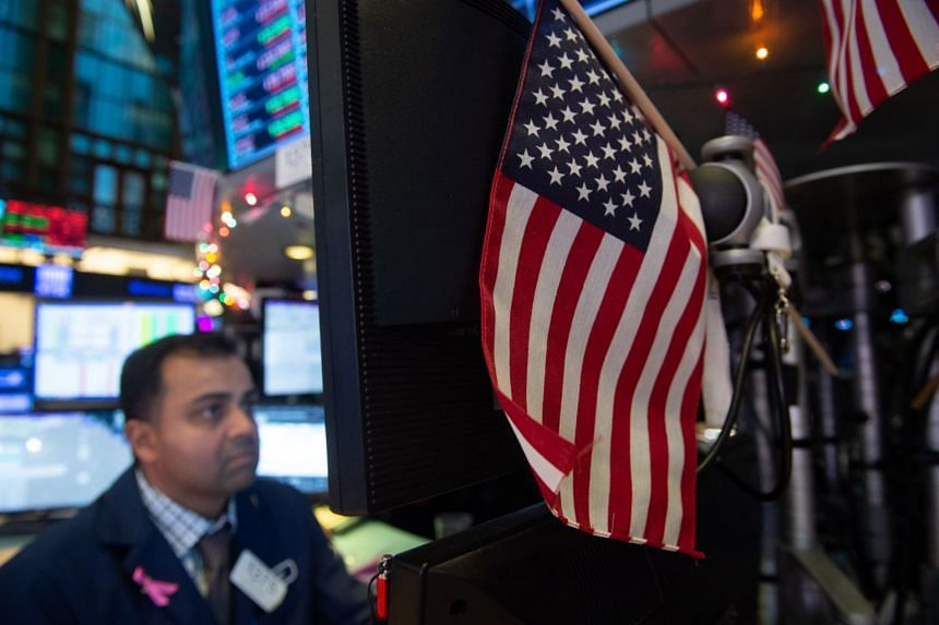 Traders work on the floor at the closing bell of the Dow Industrial Average at the New York Stock Exchange.