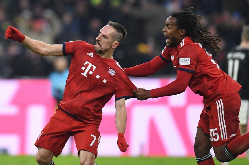 Bayern Munich's Franck Ribery (left) and  Renato Sanches celebrate after the first goal for Munich during the match between 1 FC Bayern Munich and RB Leipzig on Dec 19, 2018.