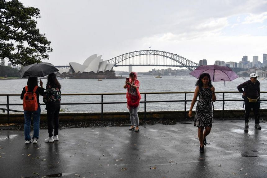 The storm struck various parts of Sydney between 4pm and 6pm local time, as thick grey clouds shrouded Australia's largest city in darkness.