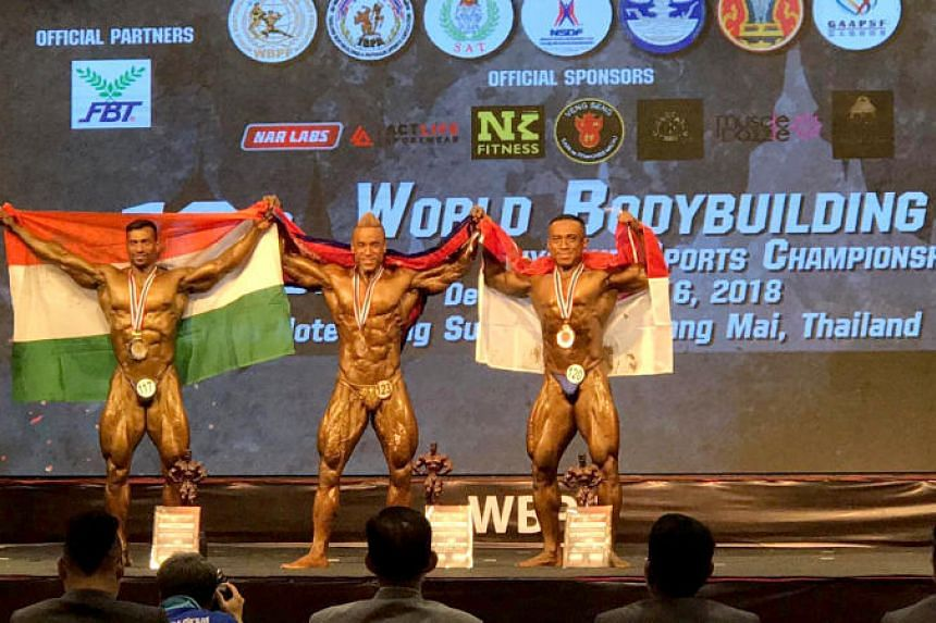 Singapore's Shaifulhaq Ahmad Ishak (right) won bronze in the men's 75kg bodybuilding category.