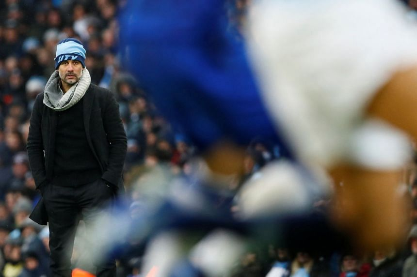 Manchester City manager Pep Guardiola looking on as City play Everton.