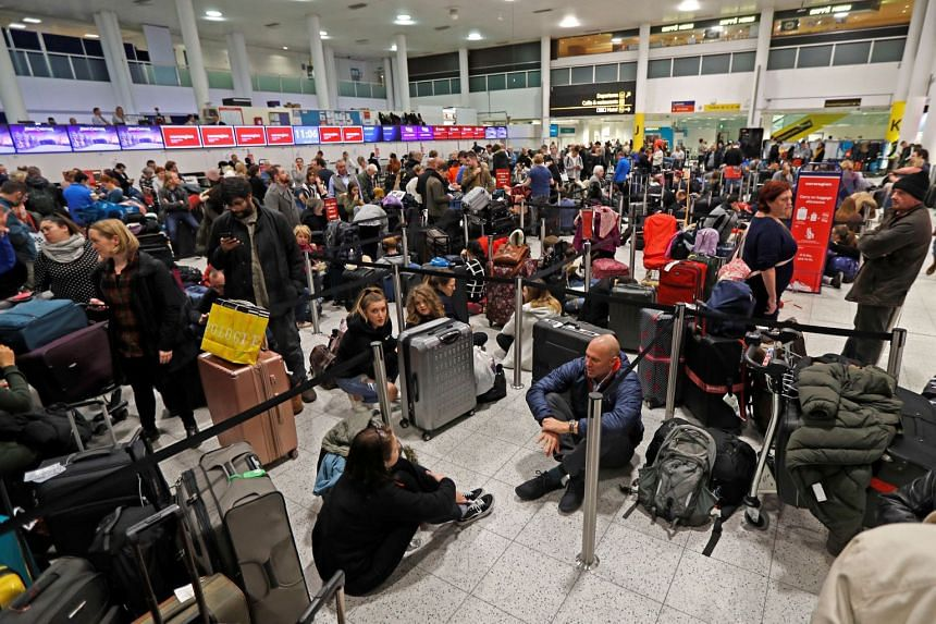 Passengers wait around in the South Terminal building at Gatwick Airport after drones flying illegally over the airfield forced the closure of the airport.