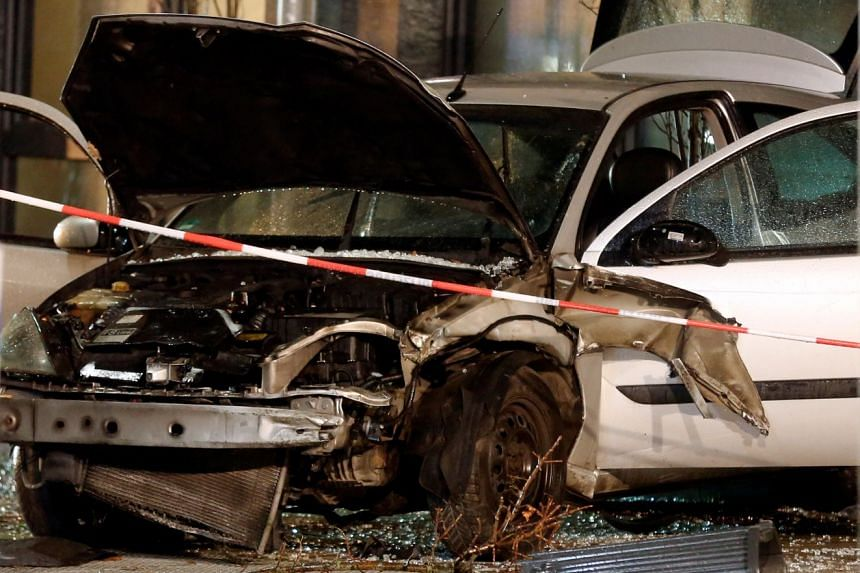 A car is seen after it plowed into a bus stop in Recklinghausen, Germany, Dec 20, 2018.