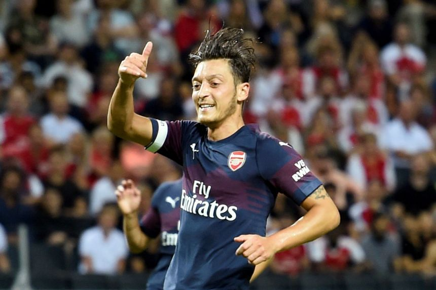 Arsenal's Mesut Ozil gestures during a match.