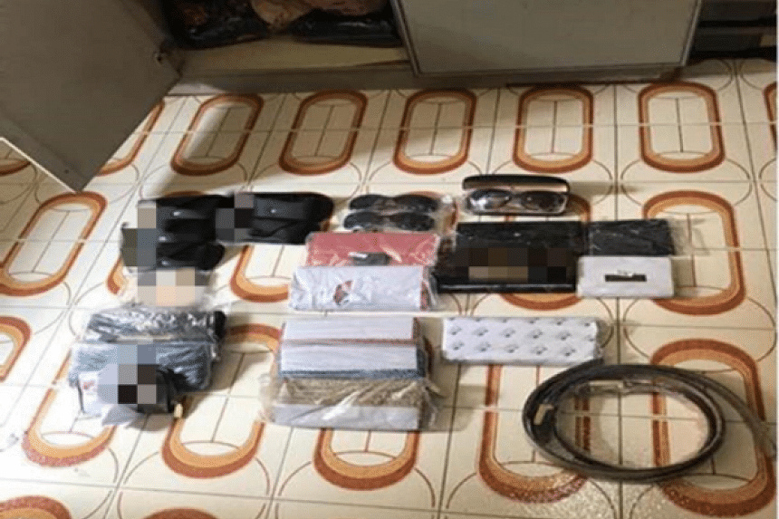 More than 400 pieces of counterfeit items with an estimated street value of more than $13,000 were seized in the joint operation on Wednesday. PHOTO: SINGAPORE POLICE FORCE