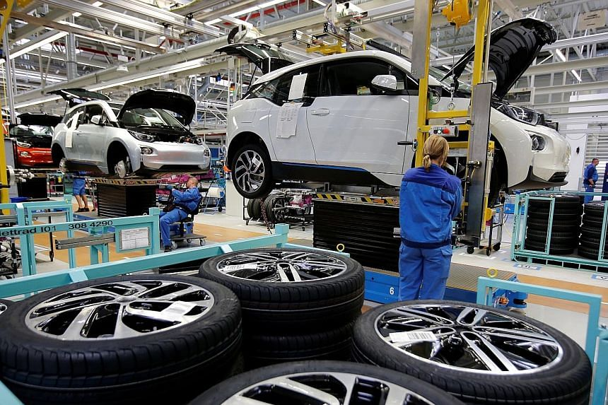 A BMW factory in Leipzig, Germany, in 2013. Carmakers are joining forces to cut costs and be more agile in the race to dominate digital services such as ride-hailing.