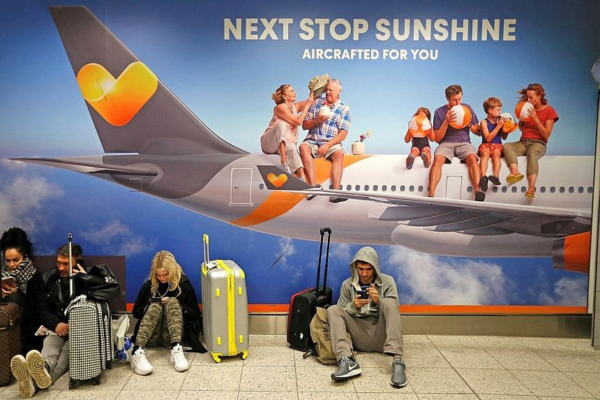 Stranded passengers waiting in the South Terminal building at Gatwick Airport yesterday. Flights were halted at Gatwick at 2103 GMT on Wednesday (5.03am in Singapore yesterday) after two drones were spotted flying near its airfield. Police said more