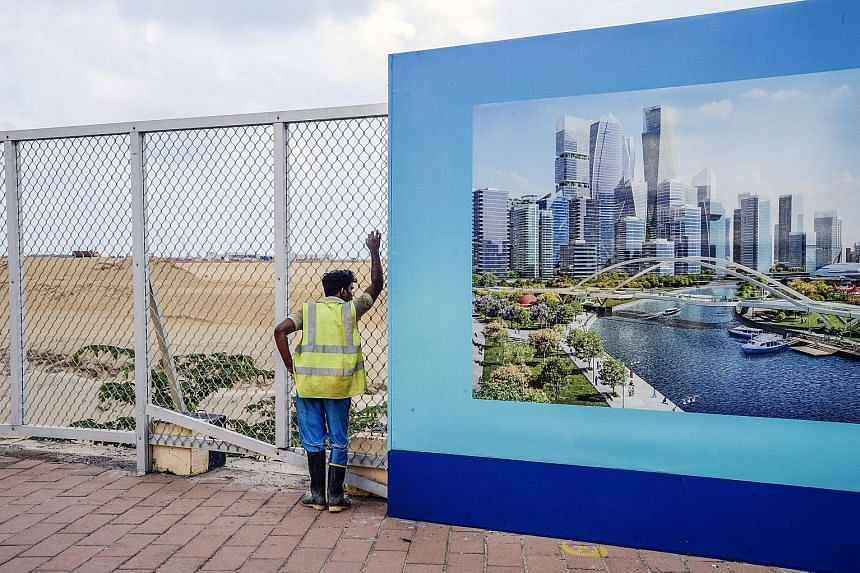 The site of Colombo Port City in Sri Lanka, and a hoarding showing an artist's impression of the Colombo International Financial City project, both of which are being developed by a Chinese firm.