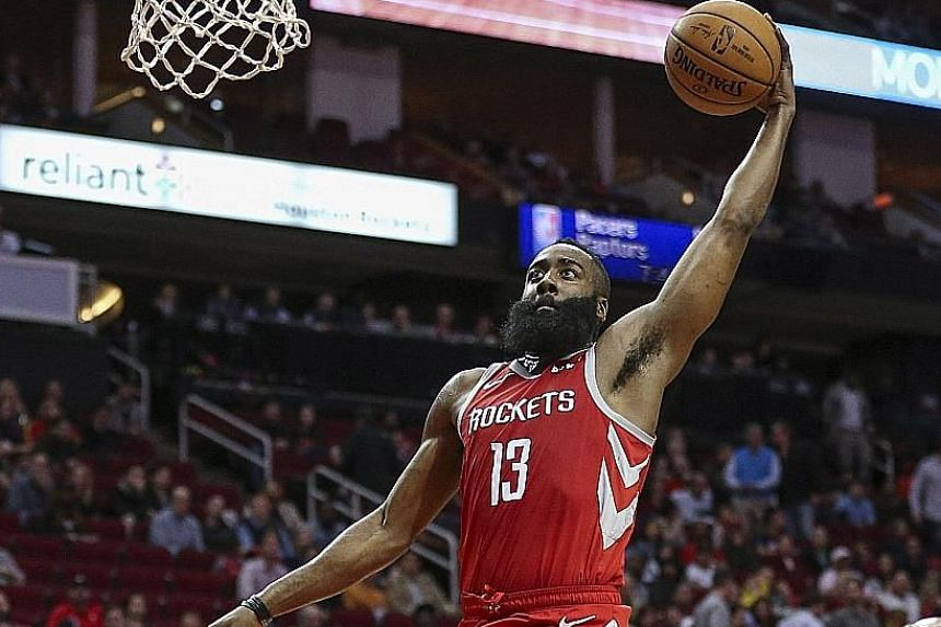 Houston Rockets guard James Harden taking off for two of his 35 points in his team's 136-118 win over the Washington Wizards at Toyota Centre. He also scored six three-pointers as Houston won their fifth straight.
