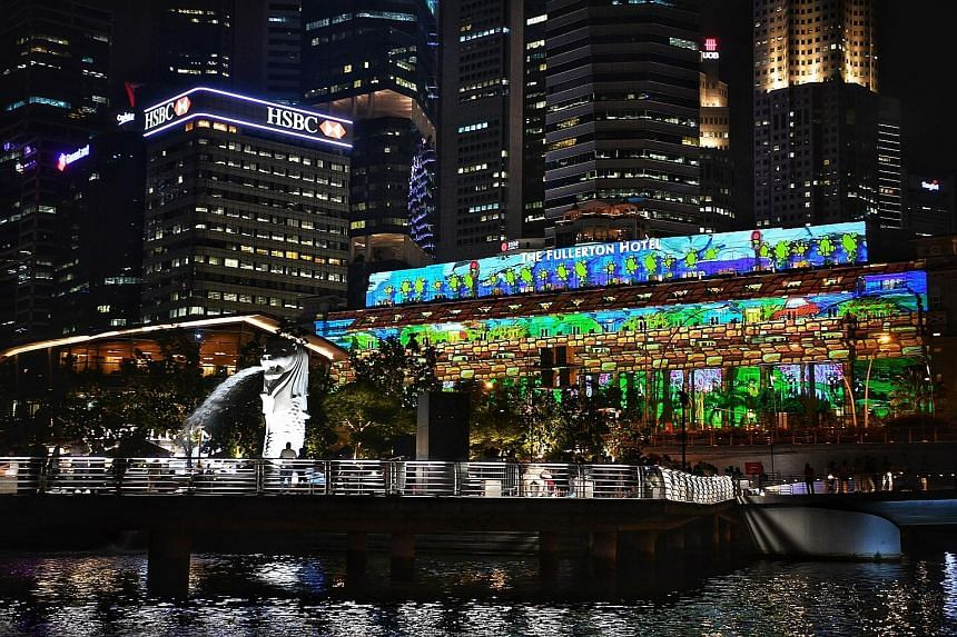 The community will take centre stage at this year's Marina Bay Singapore Countdown, whose dazzling light projections will feature works of art by students and beneficiaries of local schools and welfare organisations. The facade of The Fullerton Hotel