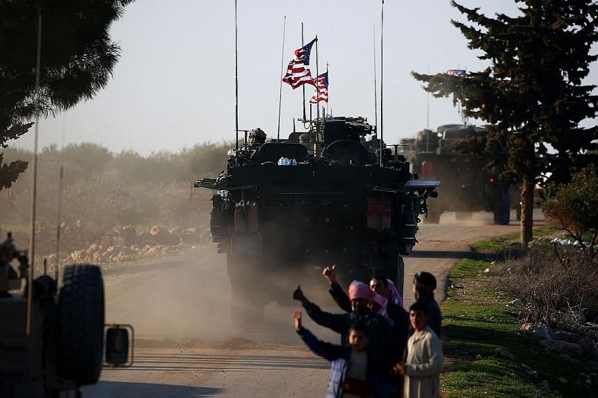 A US army convoy in northern Syria last year. An abrupt departure of American forces will almost certainly accelerate the Islamic State in Iraq and Syria's resurgence, officials and security experts say.