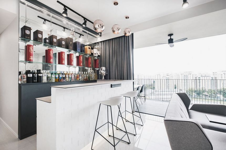 Regional claims manager Andy Fong and his wife Candy Low regularly invite friends and family over for drinks at their home bar in their three-bedroom executive condominium in Punggol.