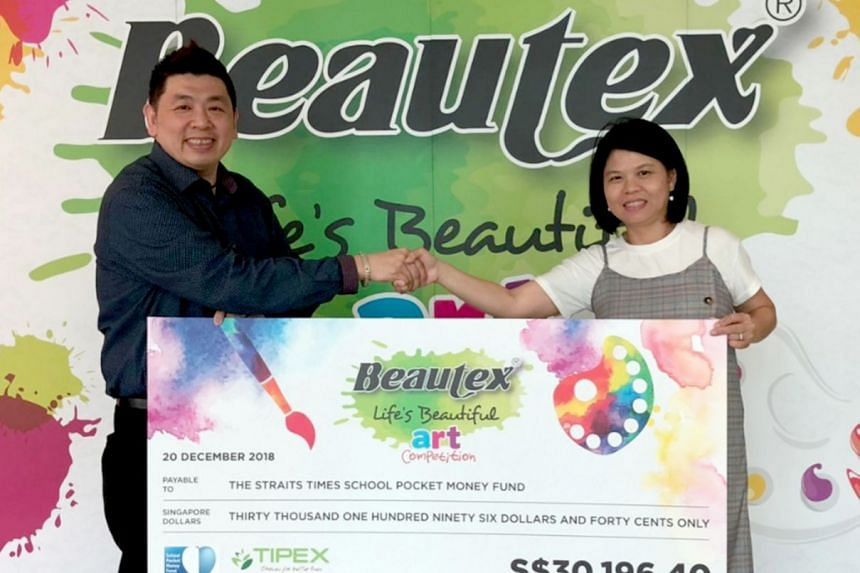 Ms Tan Bee Heong, general manager of The Straits Times School Pocket Money Fund receiving the cheque from Mr Richard Sim, vice-president of Tipex on Dec 20, 2018.