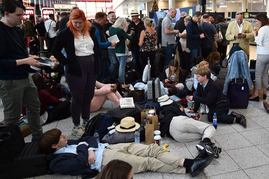 Passengers at the North Terminal at London Gatwick Airport on Dec 20, 2018, after all flights were grounded due to drones flying over the airfield.