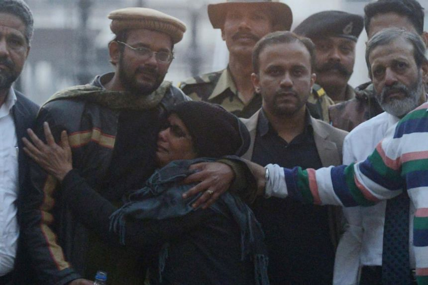 Released Indian prisoner Hamid Nehal Ansari (left), accompanied by his mother Fauzia Ansari, father Nehal Ansari (right) and brother Dr Khalid Ansari (third from right), arrives at the India Pakistan Wagah border on Dec 18, 2018.