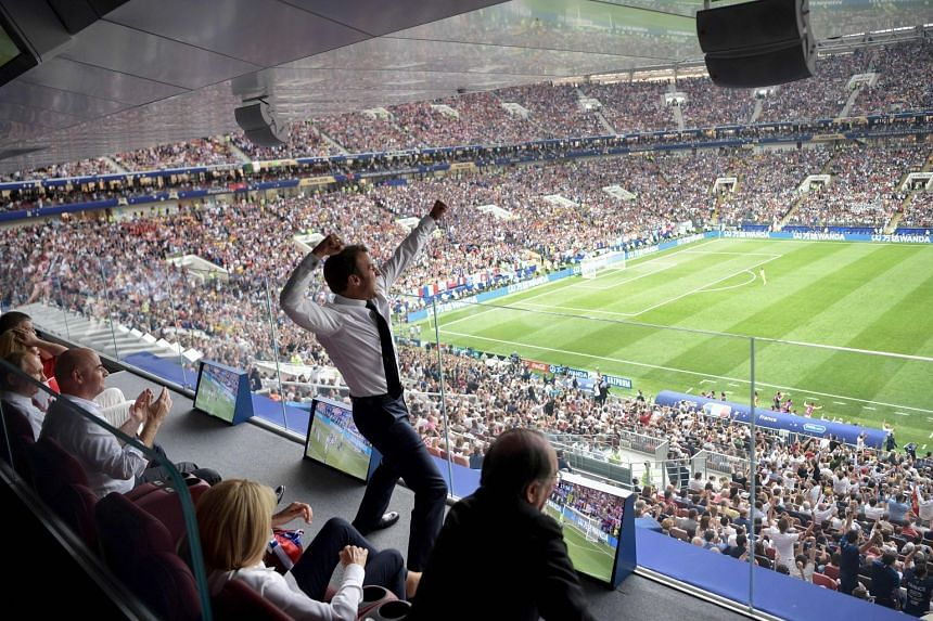 French President Emmanuel Macron reacts during the Russia 2018 World Cup final match between France and Croatia at the Luzhniki Stadium in Moscow on July 15, 2018.
