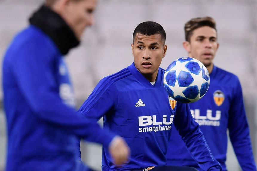 Jeison Murillo (centre) juggles with a ball during a Valencia training session.