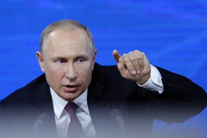 Russian President Vladimir Putin answers a question during his annual life-broadcast news conference with Russian federal, regional, and foreign media at the World Trade Center in Moscow, Russia, on Dec 20, 2018.