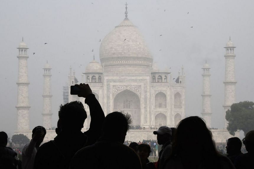 Two men set fire to the teen in the latest of a series of attacks on women in Agra, home to the Taj Mahal (above).