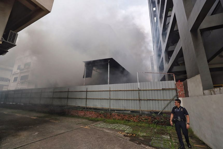 Dense grey smoke was seen billowing from the building even from hundreds of metres away.