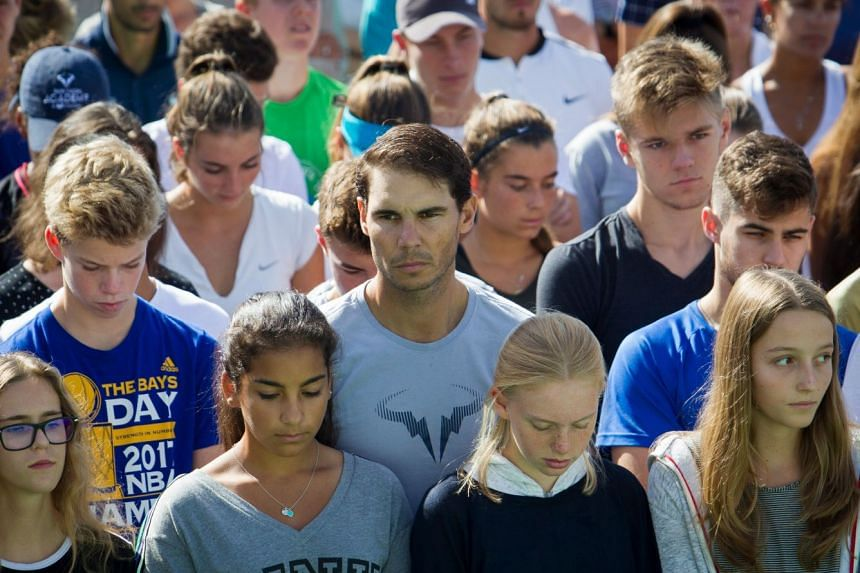 Nadal (centre) observing a minute of silence in October 2018 to honour the flood victims.