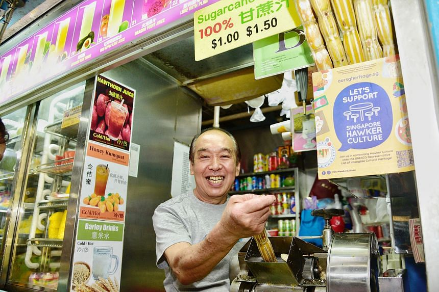 """Mr Koo Fook Tho (above), 65, who runs a fruit stall at Chinatown Complex Food Centre, proudly displaying the """"Let's Support Singapore Hawker Culture"""" sticker at his stall. Mr Koo, who has been operating at the venue since October 1983, said hawker fo"""