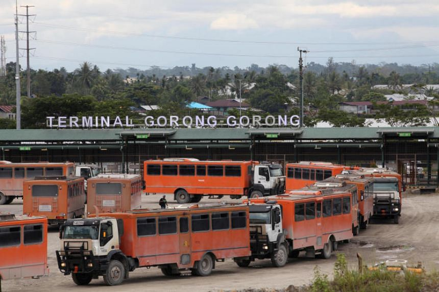Vehicles used for transporting workers to the Grasberg copper mine, operated by Freeport-McMoRan, at the Gorong-Gorong terminal in Timika,in Indonesia's Papua province, on Nov 16, 2017.
