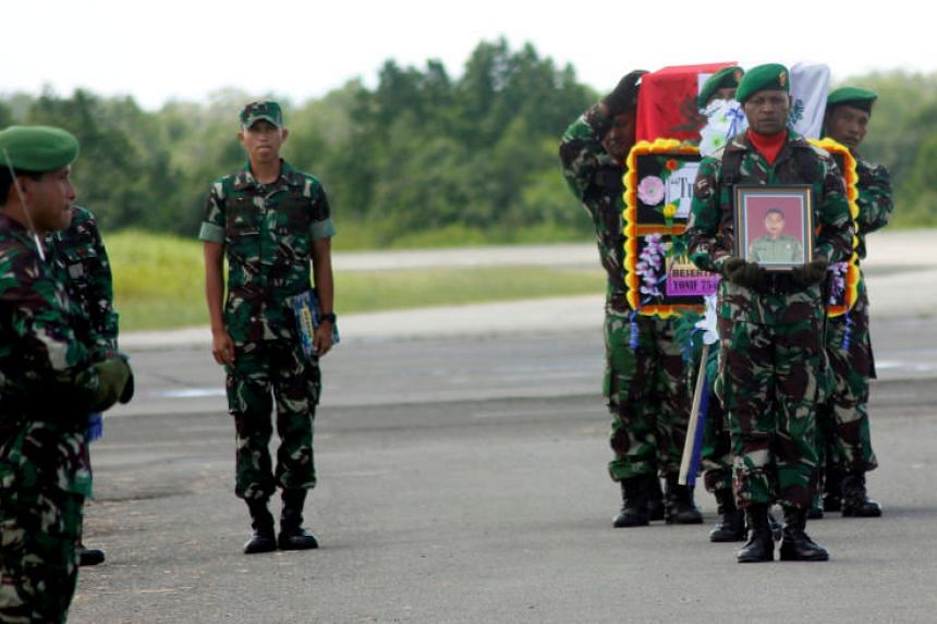 Indonesian soldiers carry the coffin of Sergeant Handoko, who was killed during a battle with a separatist group, at the airport in Sorong, West Papua, Indonesia, on Dec 6, 2018.