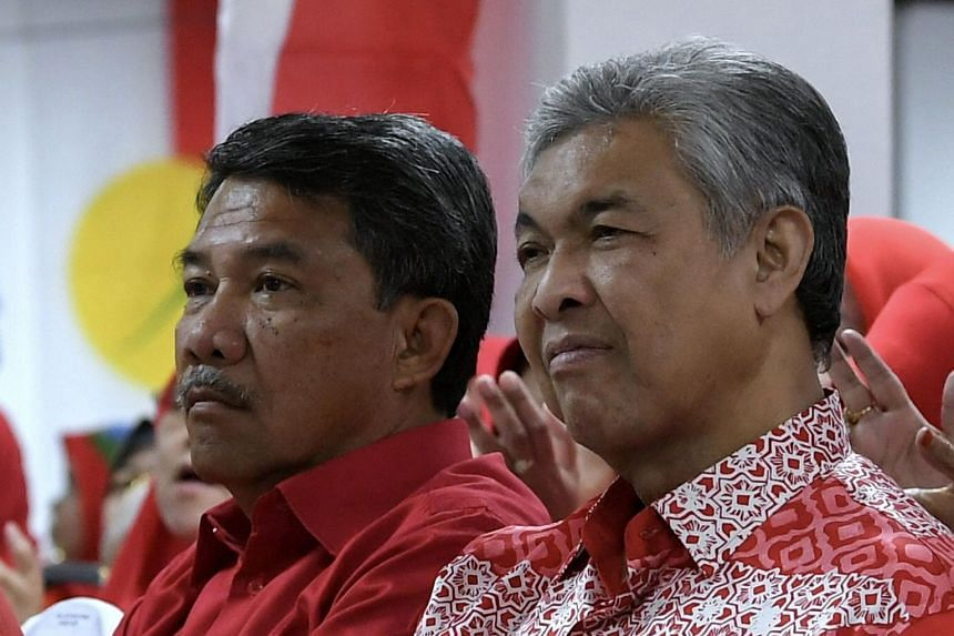 Datuk Seri Mohamad (left) replaced Umno president Ahmad Zahid Hamidi amid calls by several party leaders for him to step down for ineffectual leadership that caused 11 MPs and nine assemblymen to quit last week.