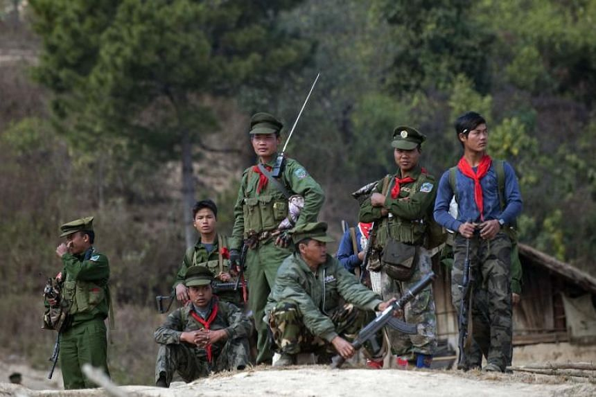 Soldiers of the ethnic armed group Taaung National Liberation Army at a village in Mantong township, in Myanmar's northern Shan state, on Jan 16, 2014.