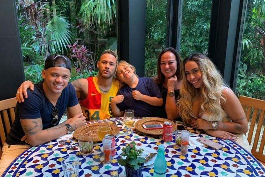 Paris Saint-Germain's Neymar in a family photo in Brazil, where the striker is currently on holiday.