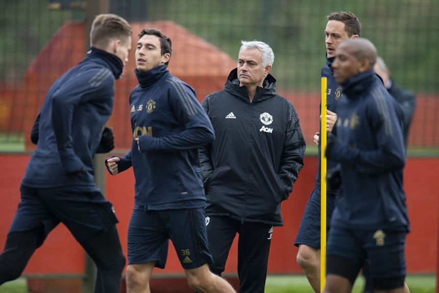 Jose Mourinho (centre) at a United training session in November 2018.