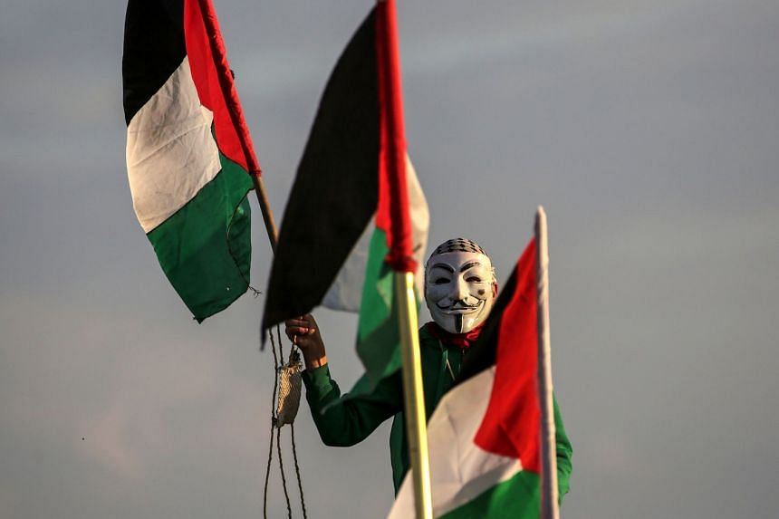 A Palestinian protester taking part in clashes near the border between Israel and the Gaza Strip.