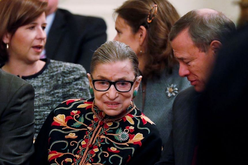 Ginsburg (centre) has had two cancerous nodules removed from her left lung.