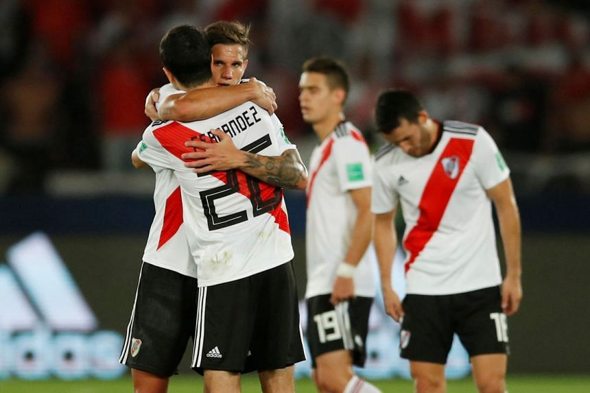 River Plate's Bruno Zuculini celebrates with Ignacio Fernandez.