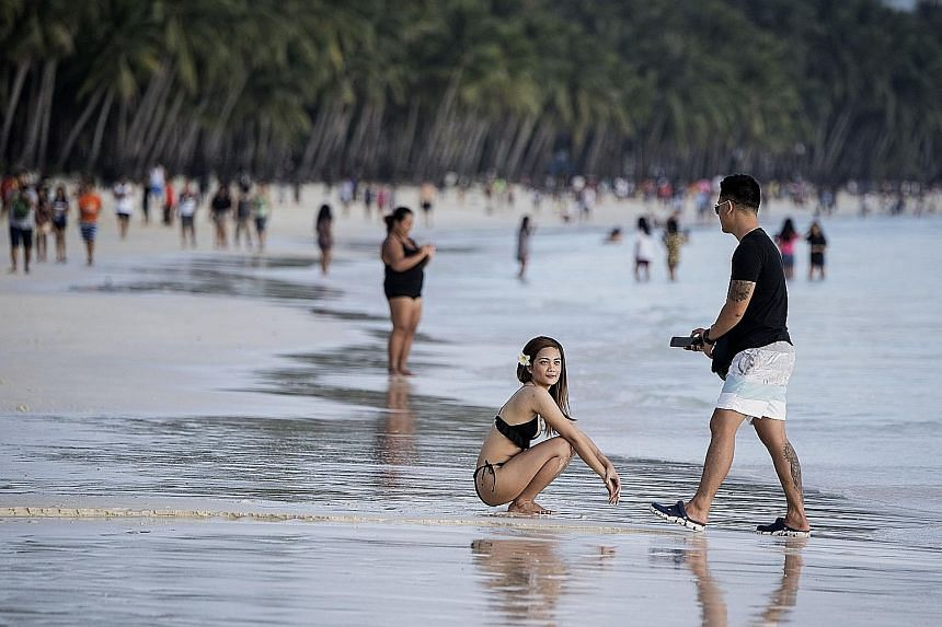 The Philippine government plans to clean up Manila Bay using the same methods it used for resort island Boracay (above) this year.
